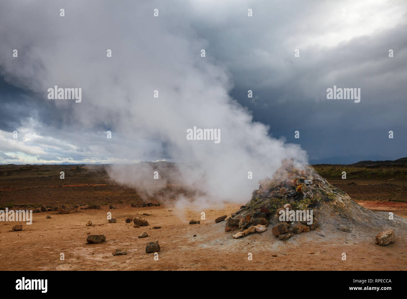 Hot steaming mud volcano or mud dome at Námafjall Hverir geothermal area in Mývatn region, Northeastern Iceland, Scandinavia - Stock Image