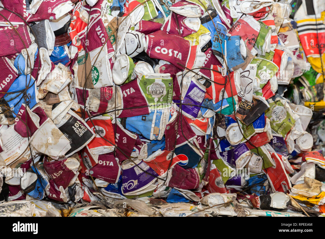 A pile of currently non-recyclable paper coffee cups from a selection of UK outlets - Stock Image