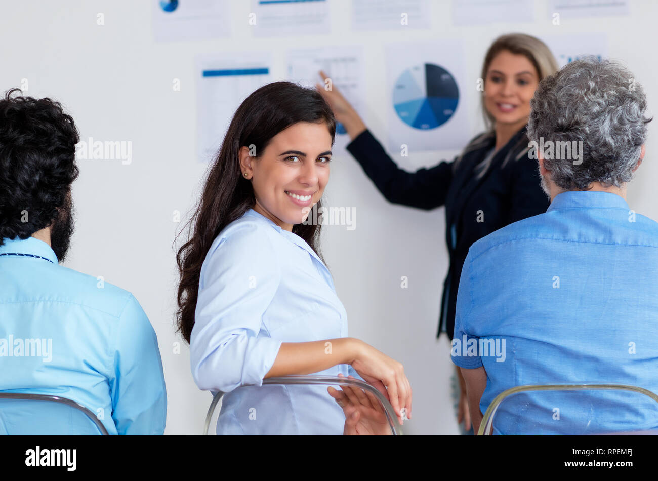 Laughing turkish businesswoman at conference at office of modern company - Stock Image