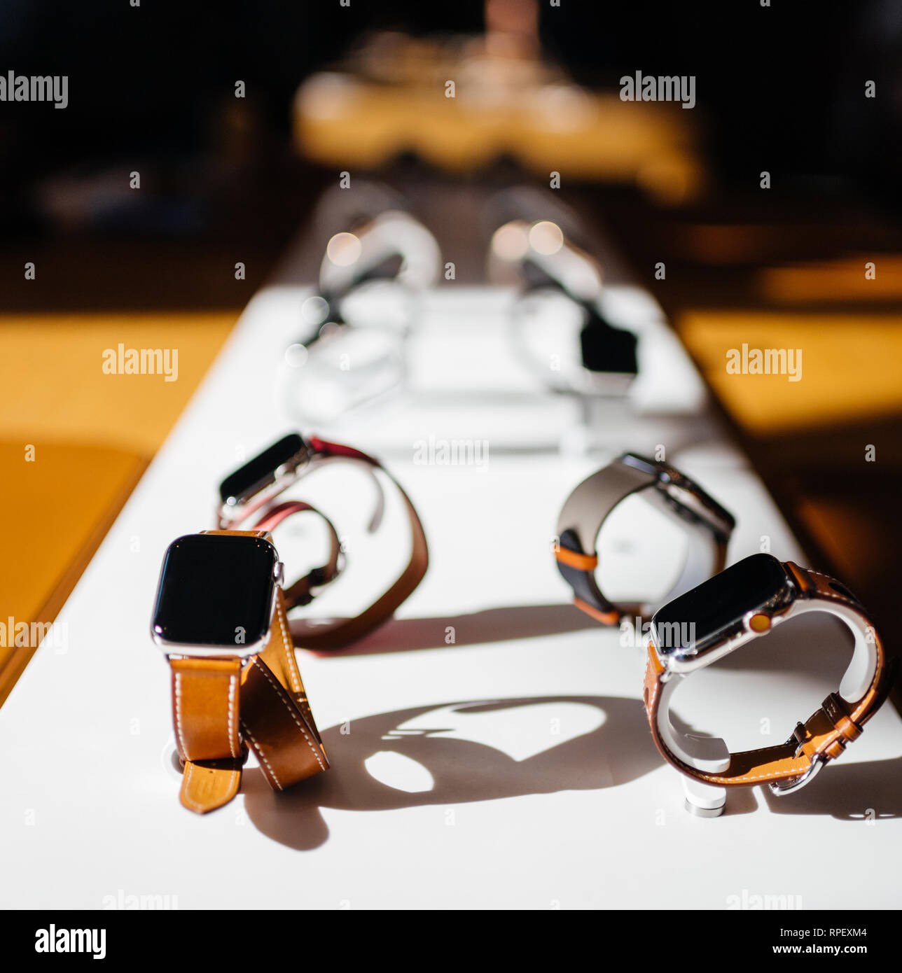 PARIS, FRANCE - OCT 26, 2018: Hero object of the latest Apple Watch Series 4 in Apple Store Computers - focus on Hermes Luxury Watch - Stock Image