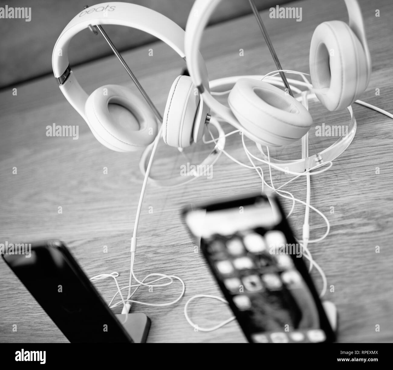 PARIS, FRANCE - OCT 26, 2018: Detail of Apple iphone and Beats by Dr Dre headphones in Apple Store computers - Stock Image