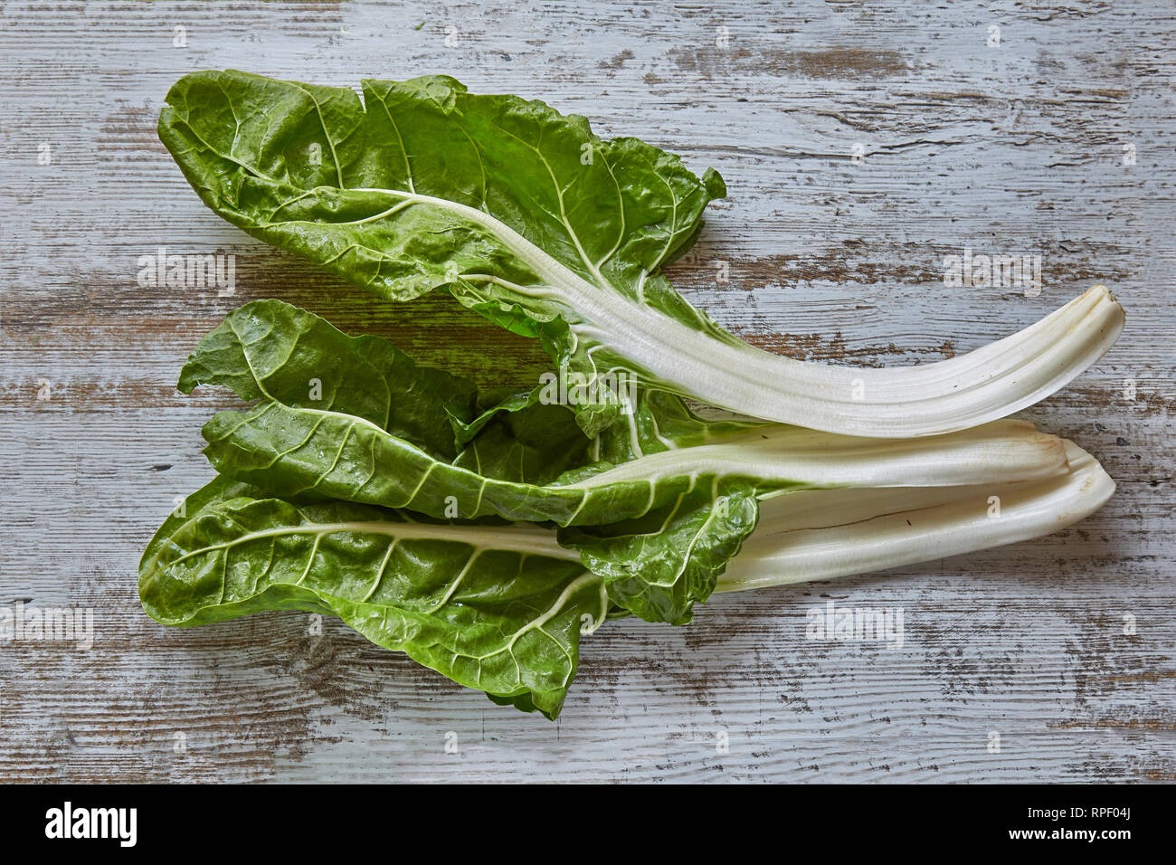 Healthy vegetable chard on a rustic wooden board. Plant, cuisine - Stock Image
