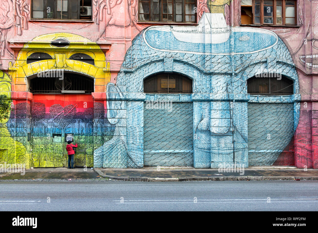 ROME - A squated former military barrack in Ostiense is covered with gigantic alien faces by Italian artist BLU. - Stock Image