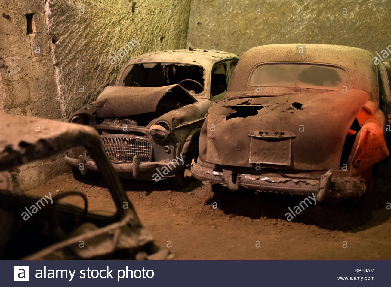 NAPLES - Crashed antique cars inside a tunnel at the Galleria Borbonica. - Stock Image