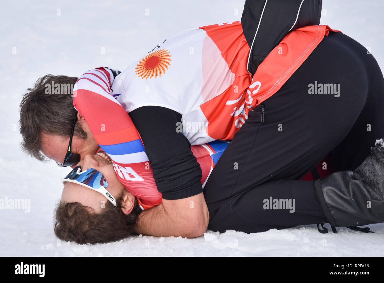 Seefeld, Austria. 21st Feb, 2019. Gleb Retivykh of Russia gets a hug from a coach at the finish line after finishing third in the men's 1.6-k freestyle sprint race at the 2019 world nordic ski championships. Credit: John Lazenby/Alamy Live News - Stock Image