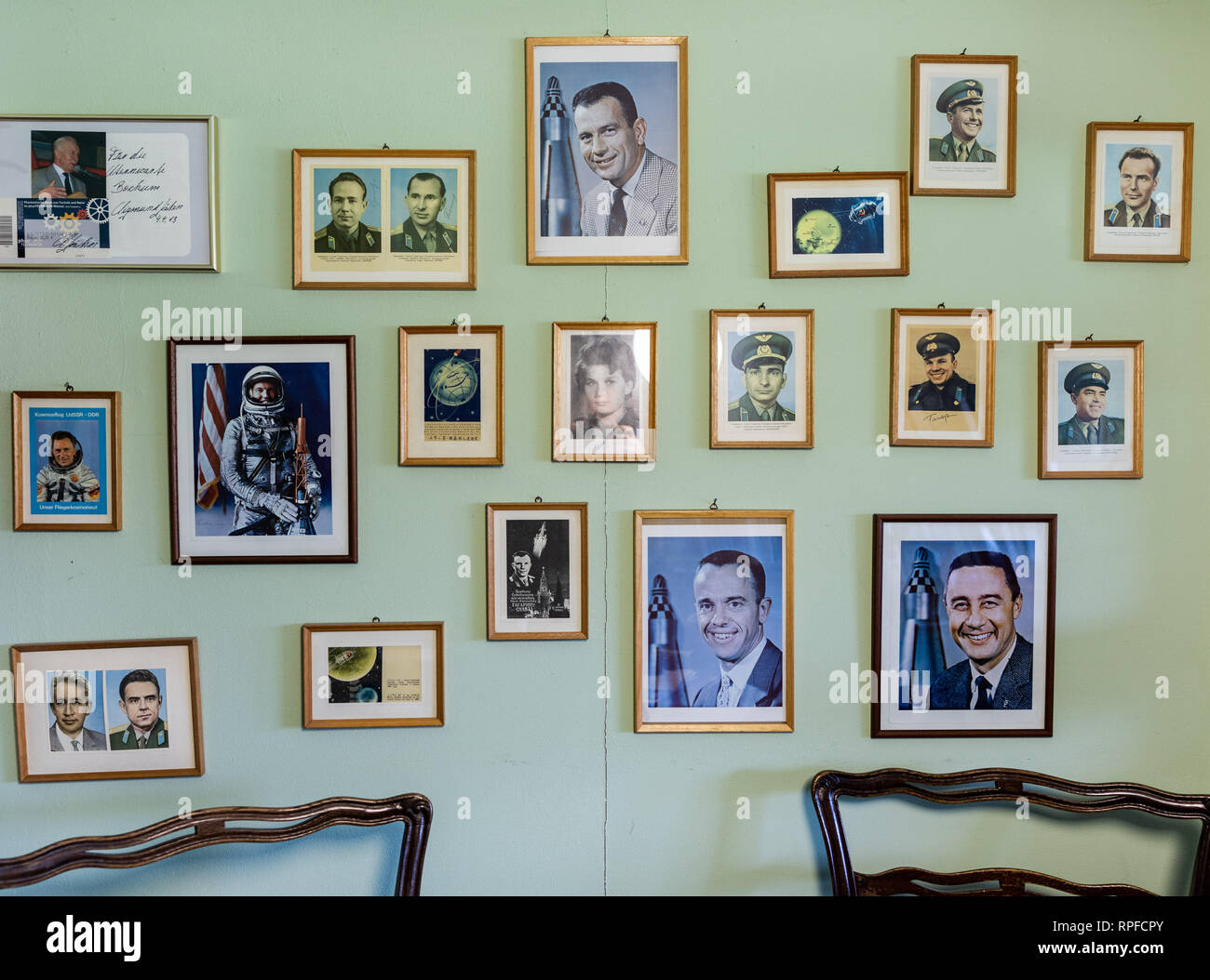 Bochum, Germany. 19th Feb, 2019. An ancestral gallery of famous cosmonauts hangs in the office of Thilo Elsner, head of the Bochum Observatory. With the commissioning of a travelling satellite, the observatory in Bochum celebrates a milestone in amateur radio. Qatar OSCAR-100, or QO-100 for short, is said to be the world's first satellite to use the non-commercial amateur radio service that rotates with the Earth instead of orbiting it. (to dpa: 'Sparks like an astronaut: first travelling satellite for amateurs' ) Credit: Marcel Kusch/dpa/Alamy Live News - Stock Image