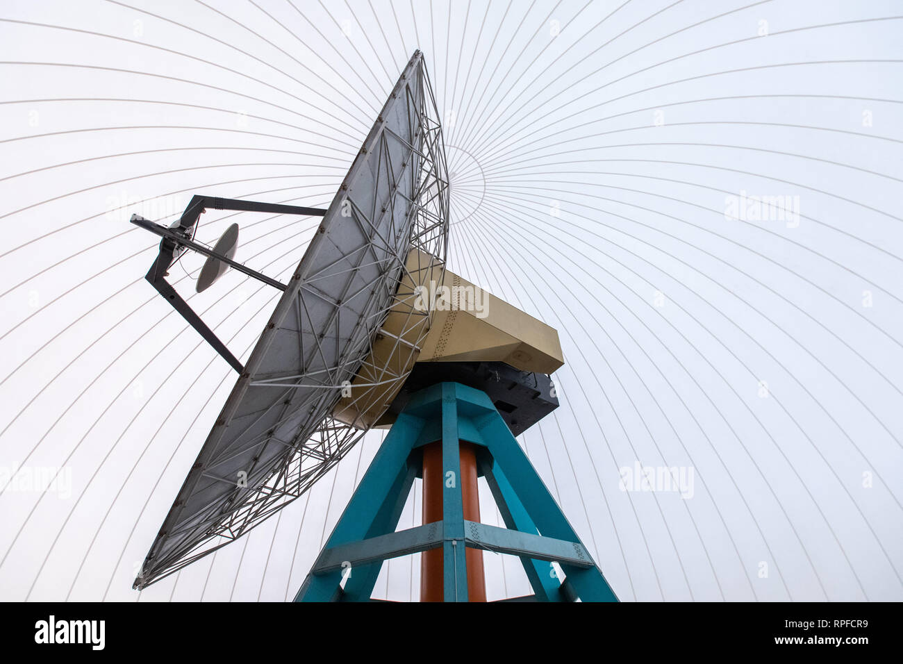 Bochum, Germany. 19th Feb, 2019. There's a parabolic antenna in the radar dome. With the commissioning of a travelling satellite, the observatory in Bochum celebrates a milestone in amateur radio. Qatar OSCAR-100, or QO-100 for short, is said to be the world's first satellite to use the non-commercial amateur radio service that rotates with the Earth instead of orbiting it. (to dpa: 'Sparks like an astronaut: first travelling satellite for amateurs' ) Credit: Marcel Kusch/dpa/Alamy Live News - Stock Image