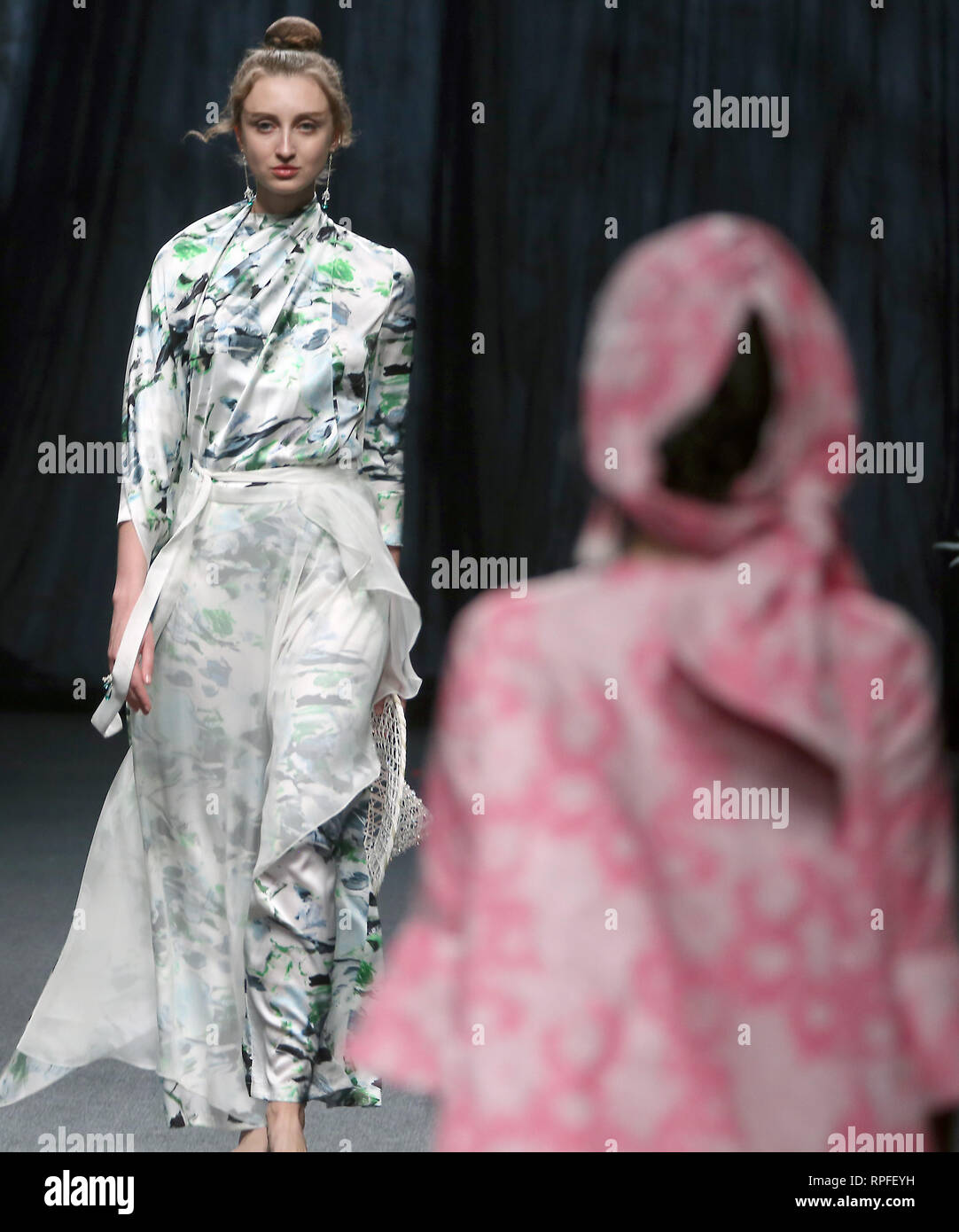 Beijing, China  1st Apr, 2018  Models wear clothing by