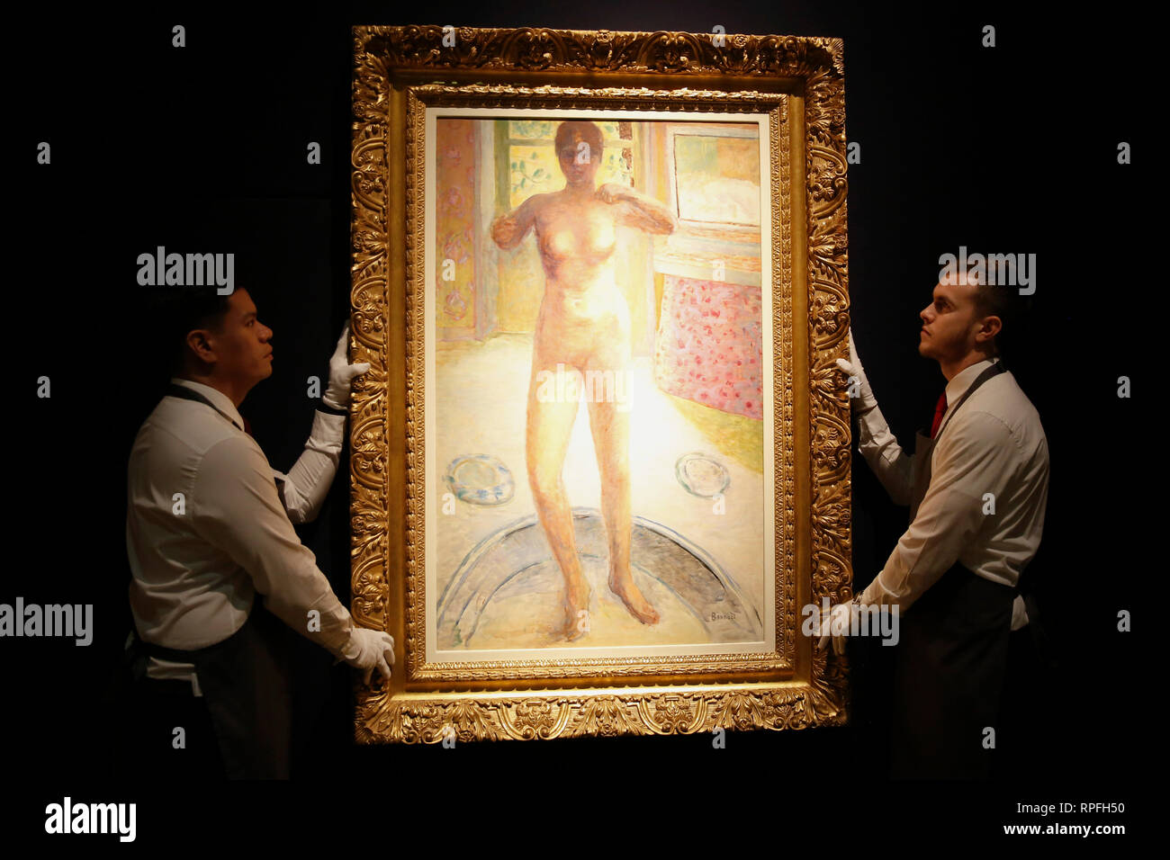 London, UK. 21st February, 2019. Christie's employees pose with artwork 'Femme au tub' by Pierre Bonnard at Christie's Auction House in London, Thursday February 21, 2019. The piece will be sold at auction during Christie's evening sale on Wednesday, and is expected to achieve an estimate of up to £6million. Photograph : Credit: Luke MacGregor/Alamy Live News - Stock Image