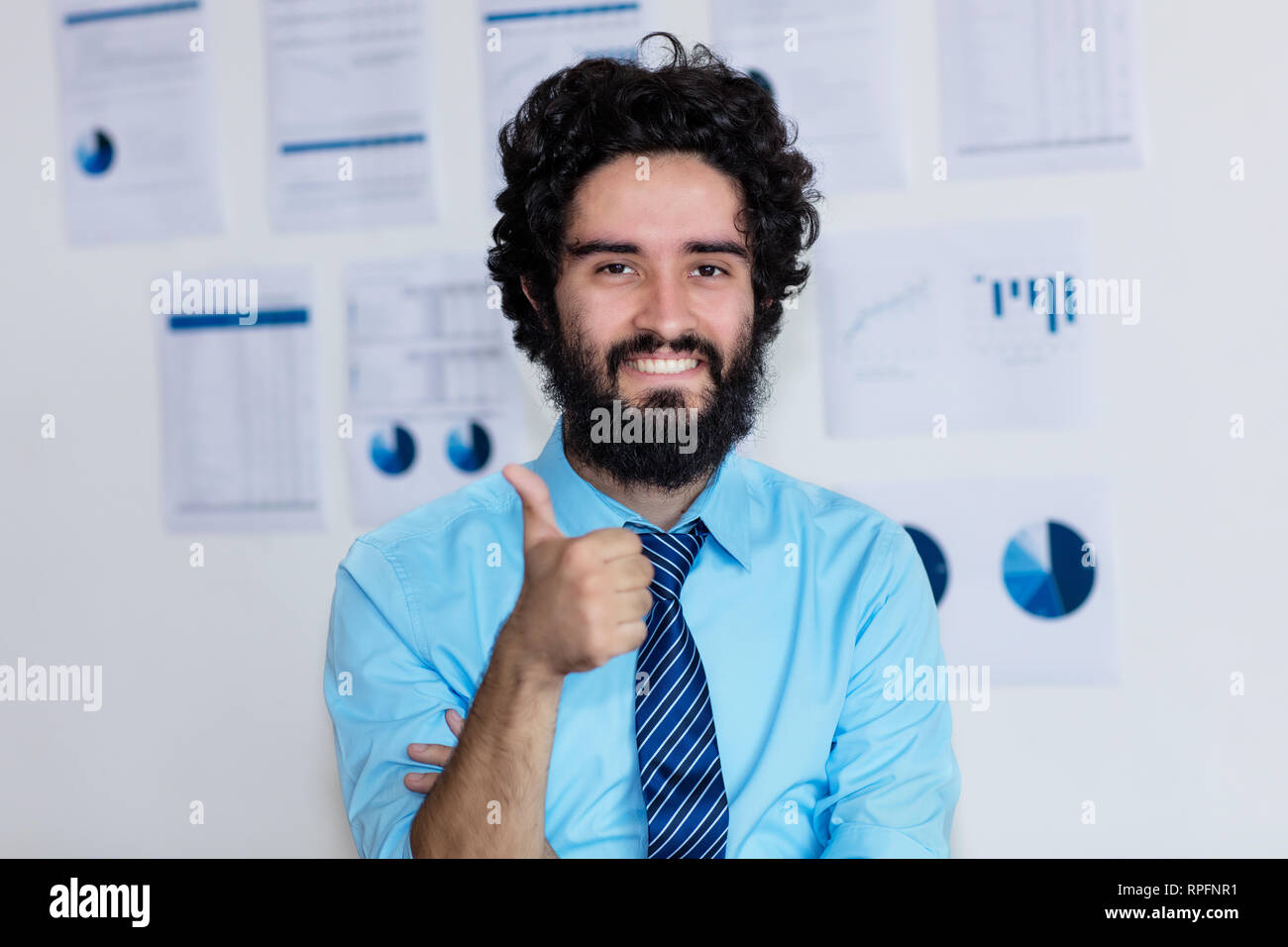 569b12a9796 Successful arabic businessman with beard and tie at office of company -  Stock Image