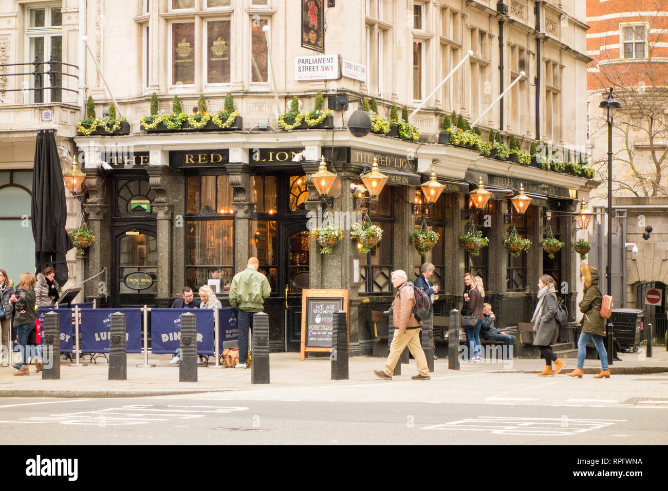 The Red Lion a Traditional English London pub on the corner of Parliament Street and Derby gate in London's Whitehall - Stock Image