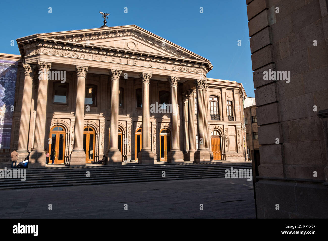 The Teatro de la Paz or Theater of Peace in the historic center on the Plaza del Carmen in the state capital of San Luis Potosi, Mexico. The building was built by the architect Jose Noriega with French influences and neoclassical style, with its facade in pink quarry in 1894. Stock Photo