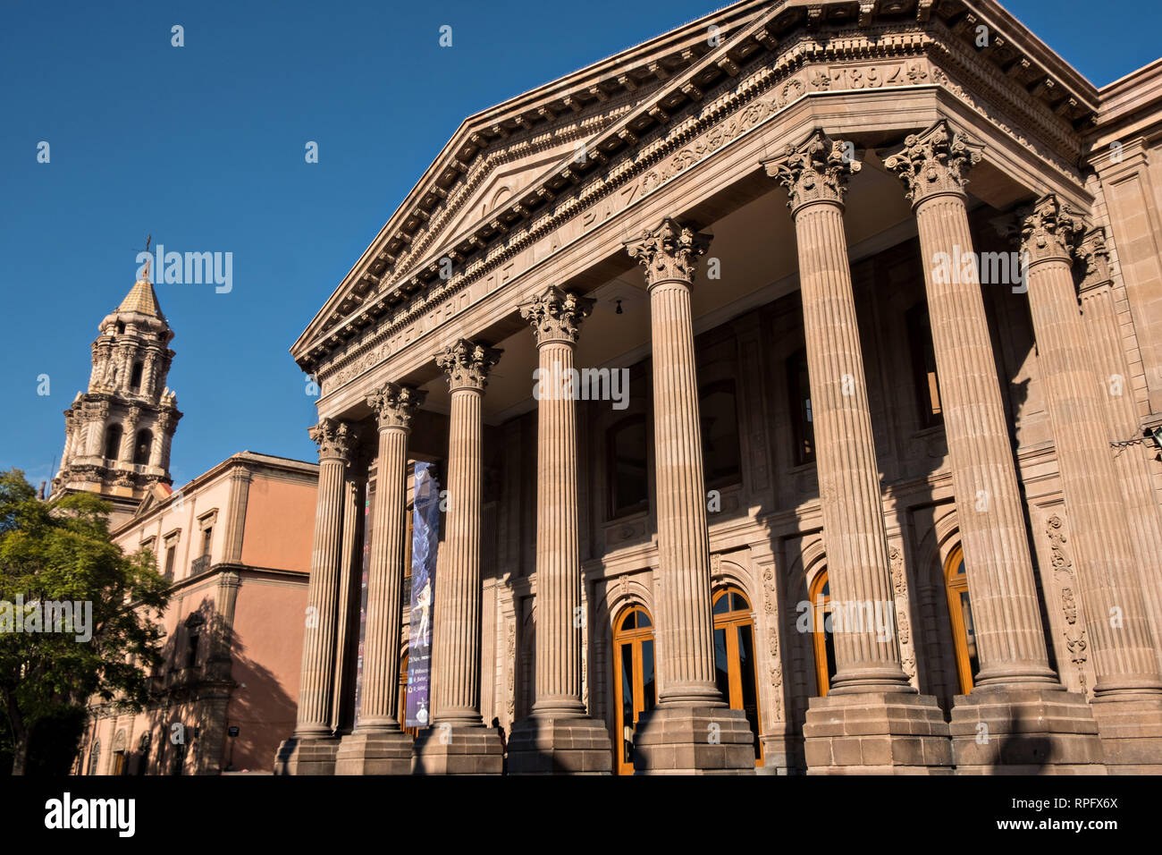 Elevated view of the Teatro de la Paz or Theater of Peace in the historic center on the Plaza del Carmen in the state capital of San Luis Potosi, Mexico. The building was built by the architect Jose Noriega with French influences and neoclassical style, with its facade in pink quarry in 1894. Stock Photo