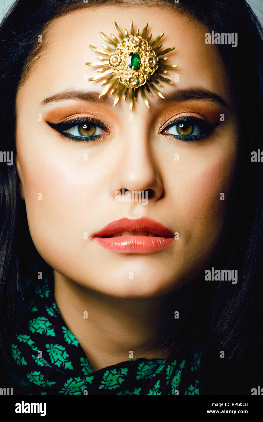 beauty eastern real muslim woman with jewelry close up, bride with star creative makeup - Stock Image