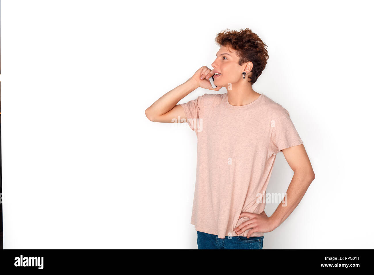 65ce3ccb3d71c Teenager with earrings studio standing isolated on white answering ...