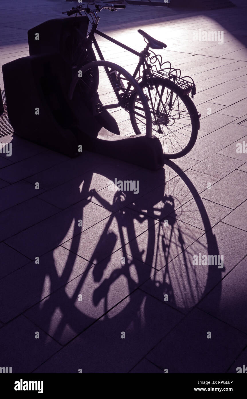 Cycle Shadow, City Centre, Black,white, commuter, traveler, transport, Manchester City Centre, England, UK - Stock Image