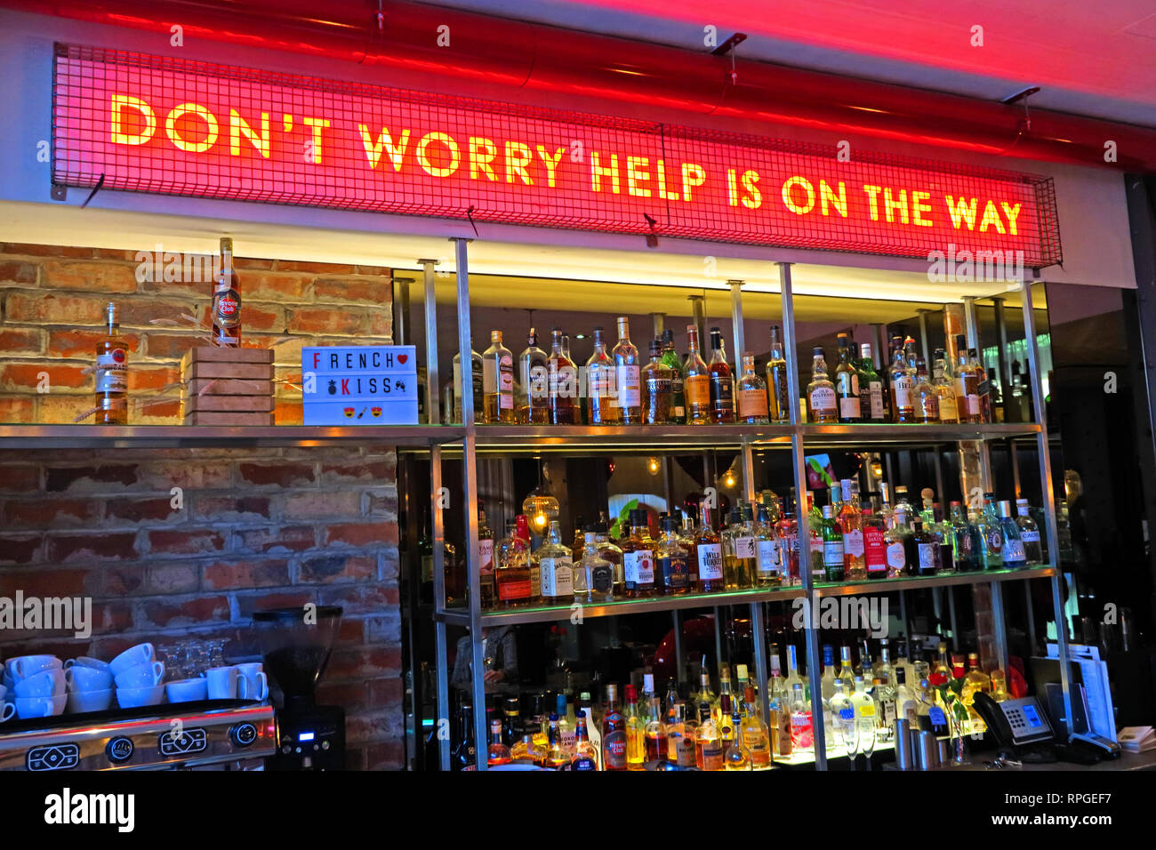 Dont Worry Help Is On Its Way, sign at Malmaison Manchester, Piccadilly, bar, North West England, UK - Stock Image