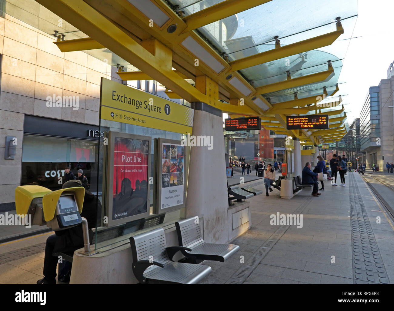 Exchange Square Manchester Metrolink tram stop, with passengers, central Manchester, North West England, UK - Stock Image