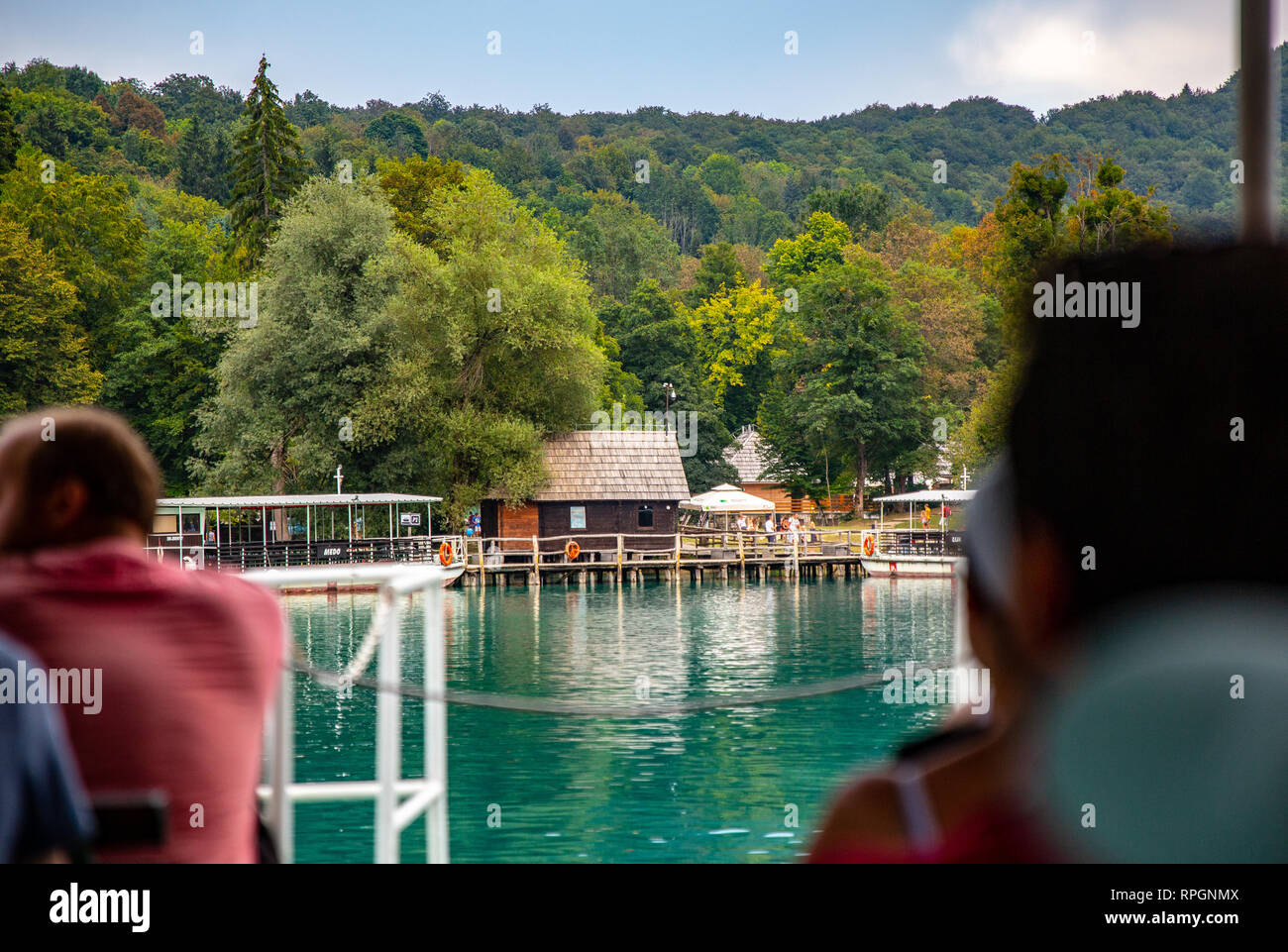 Cruising on the tourist boat at Plitvice Lakes national park in Croatia.   The boat is coming in to the landing near gate 2. - Stock Image