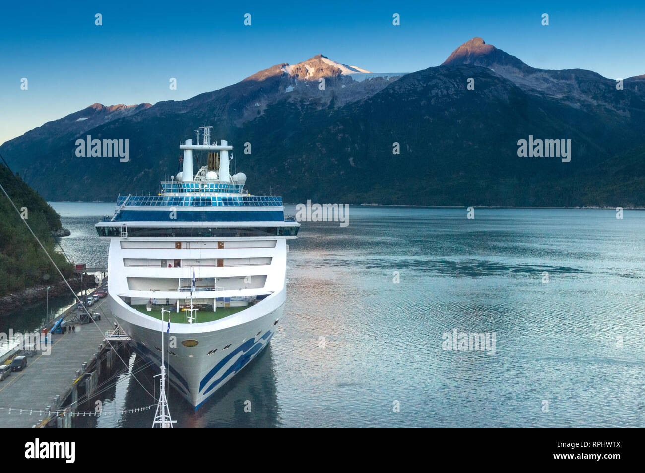 September 15, 2018 - Skagway, AK: A Princess Cruises ship docking at port in the early morning. Photographed from Holland America's The Volendam. - Stock Image