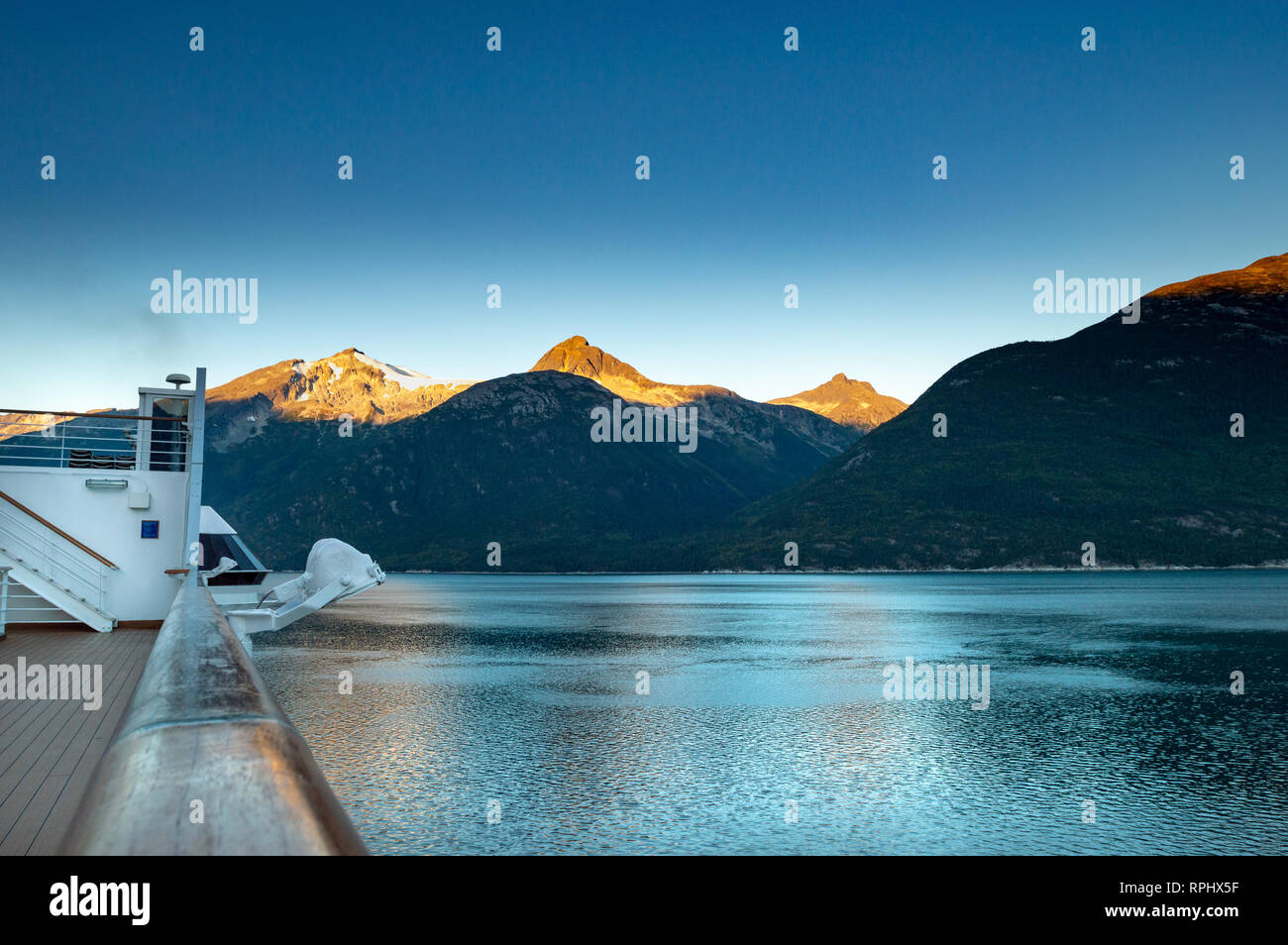 September 15, 2018 - Skagway, AK: Sunrise alpenglow light on mountains and view of Taiya Inlet from The Volendam cruise ship Sports Deck while arrivin - Stock Image