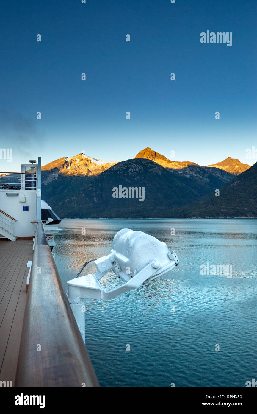 September 15, 2018 - Skagway, AK: Sunrise alpenglow light on mountains and view of Taiya Inlet from The Volendam cruise ship Sports Deck while arrivin Stock Photo