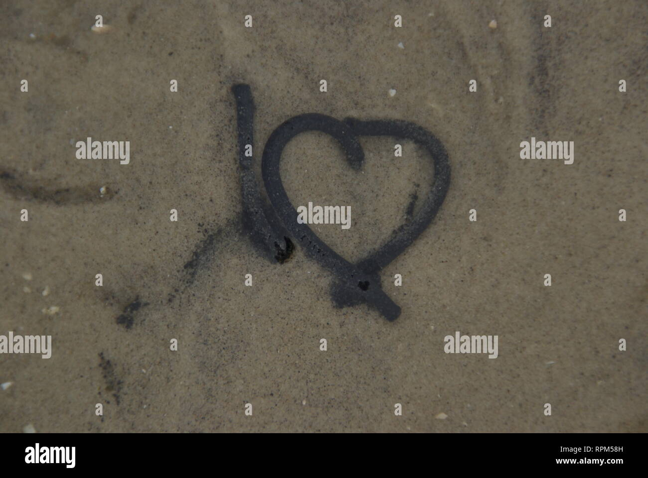 Bizarre excretion of a rock worm in shape of a heart - Stock Image