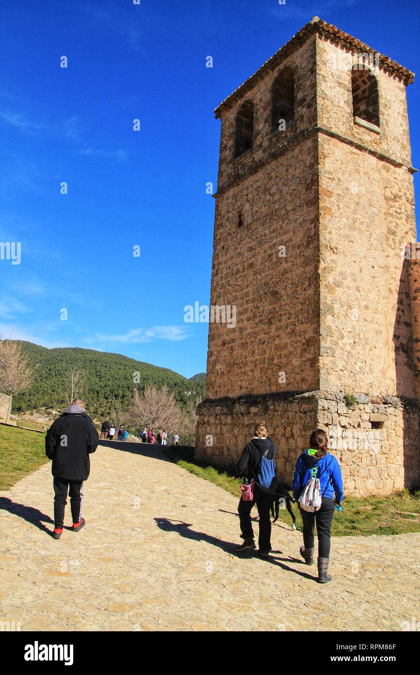 Riopar Viejo, Albacete, Spain- February 8, 2019: Tourists visiting and walking through cobbled stone streets in Riopar Viejo village, Castilla La Manc - Stock Image