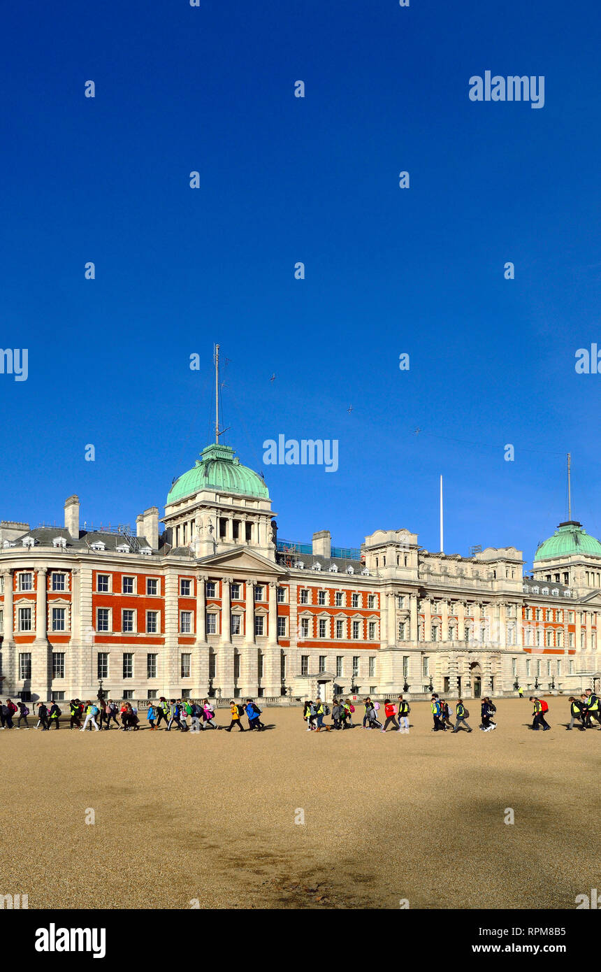 London, England, UK. Horse Guards Parade - Ministry of Defence, Old Admiralty Building - group of primary school children on a school trip - Stock Image