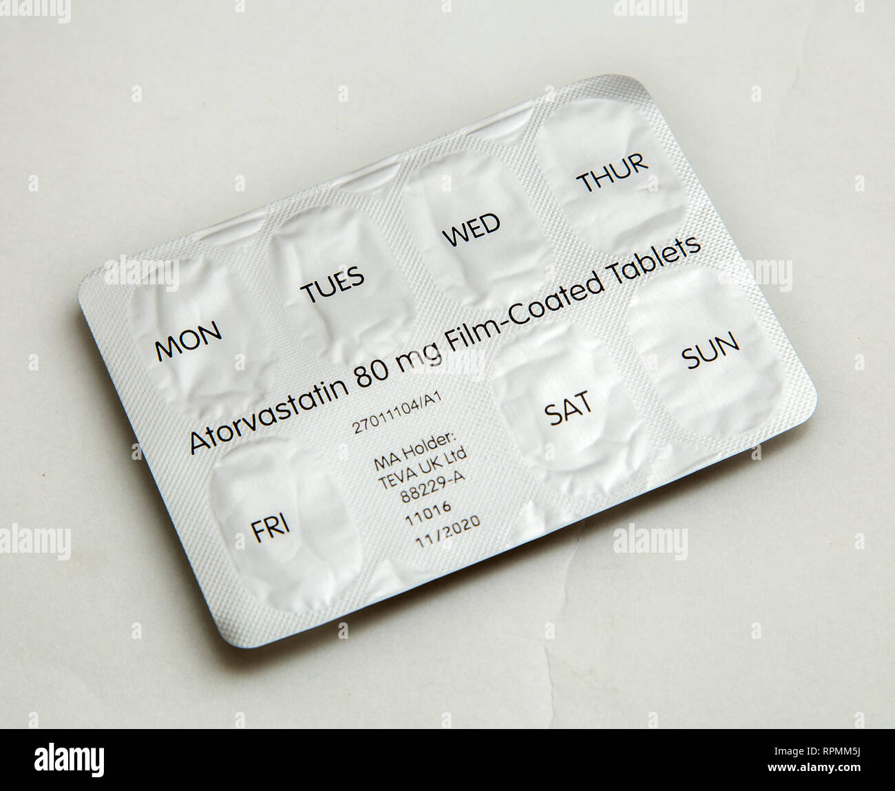 Calendar strip of Atorvastatin, a statin drug used to reduce the build up of cholesterol, prevent cardiovascular disease, and treat lipid levels. - Stock Image