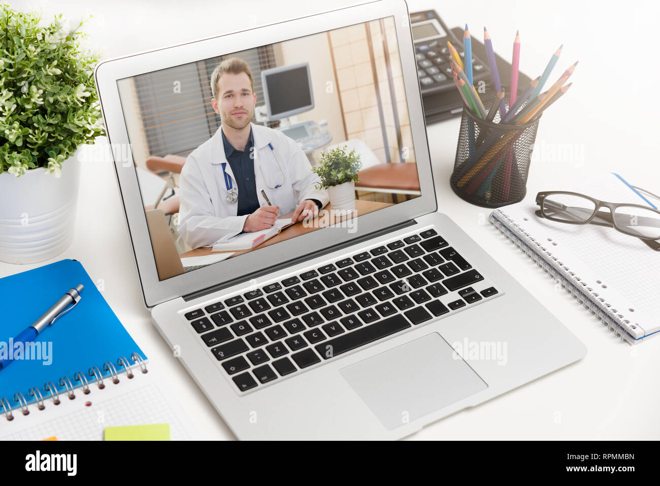 Doctor with a stethoscope on the computer laptop screen. Telemedicine or telehealth concept. - Stock Image