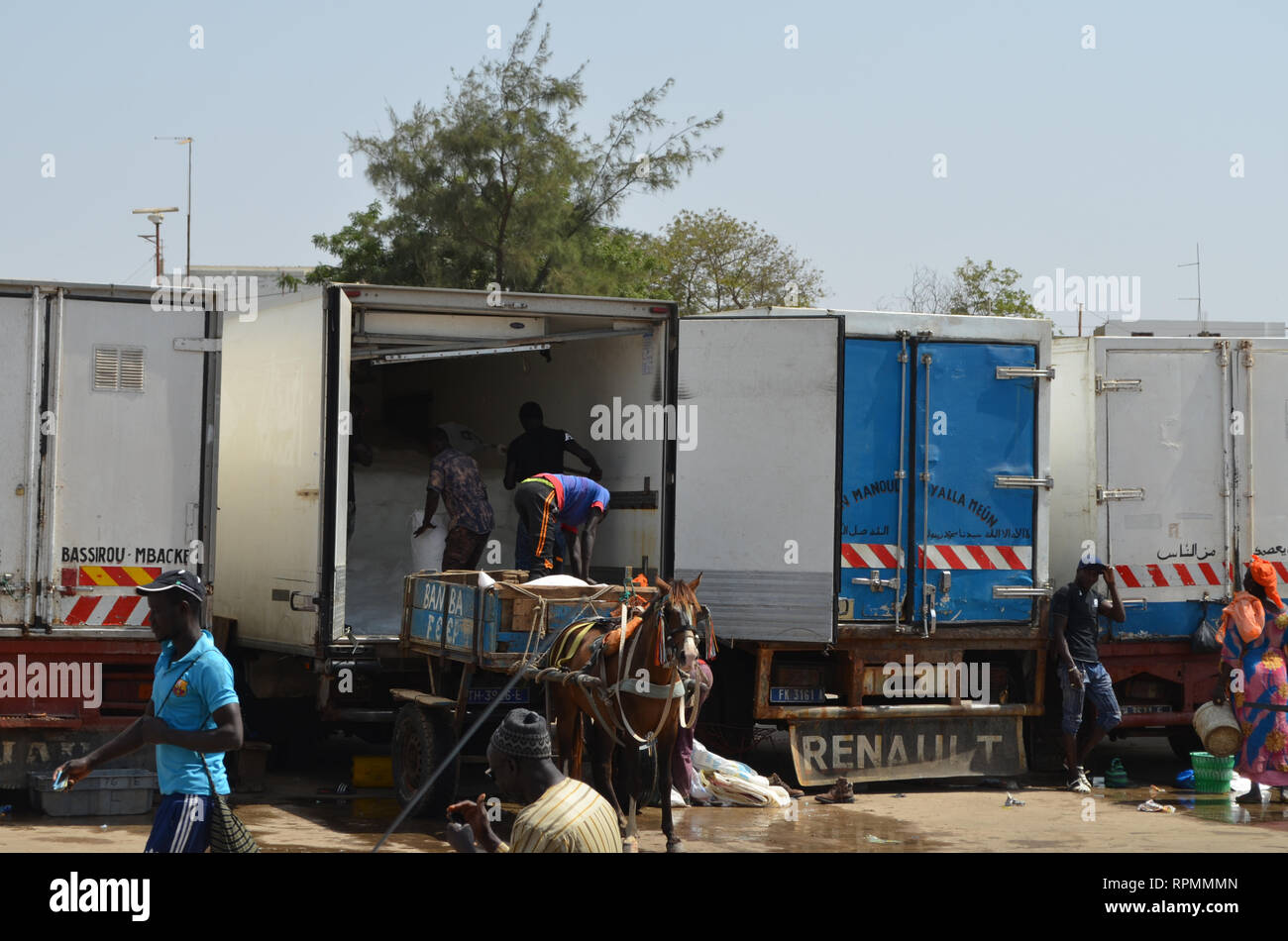 Trucks at the parking lot of Mbour fish market Stock Photo