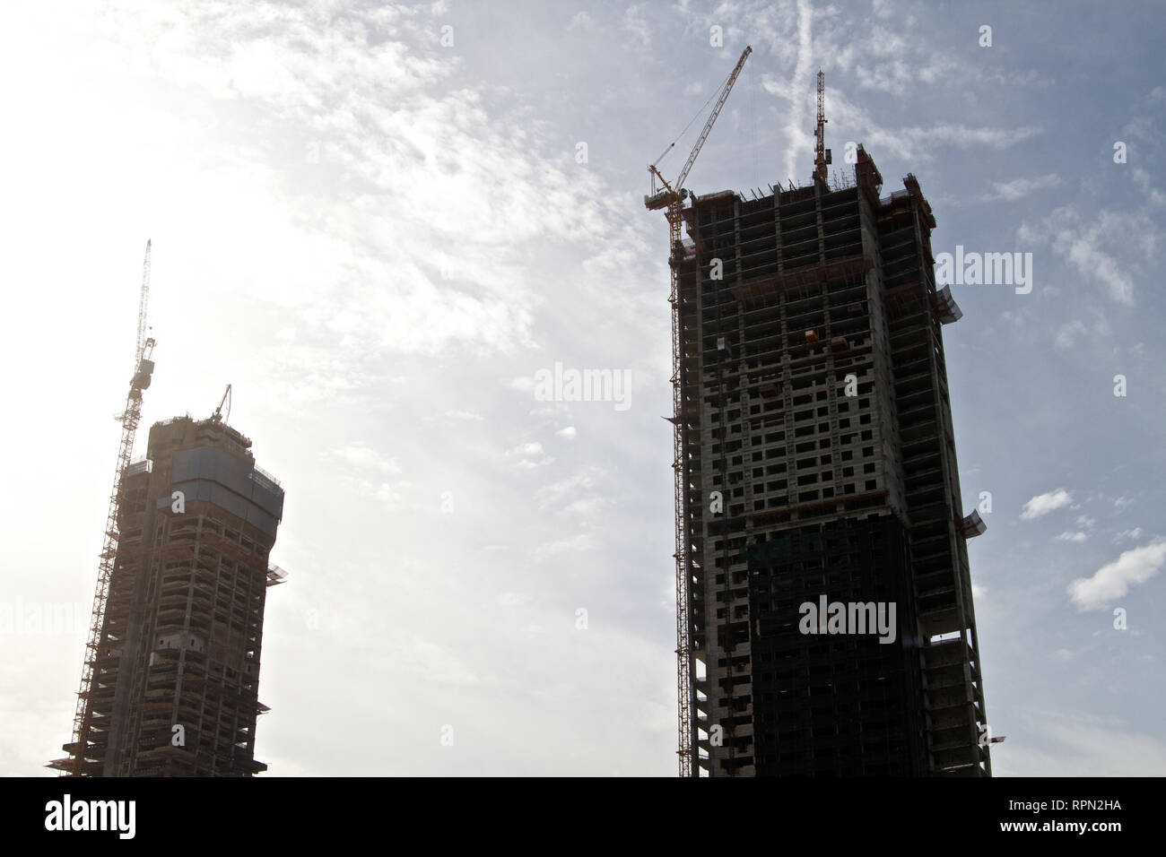 Dubai-Arki Group Design LLC building on the right and Al Hikma Tower on the left under construction - Stock Image