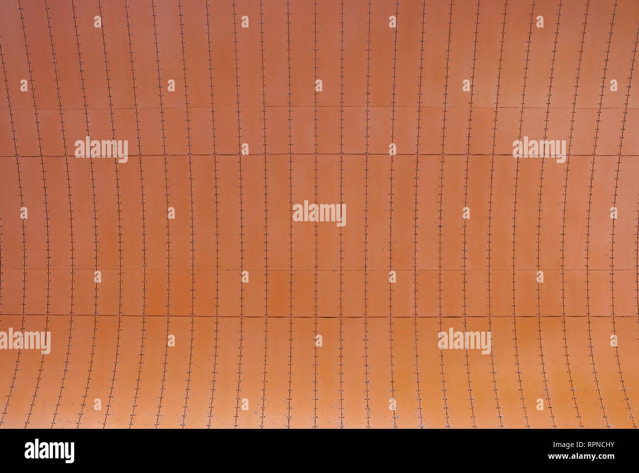 texture background metal surface evenly divided into rectangles reddish brown - Stock Image