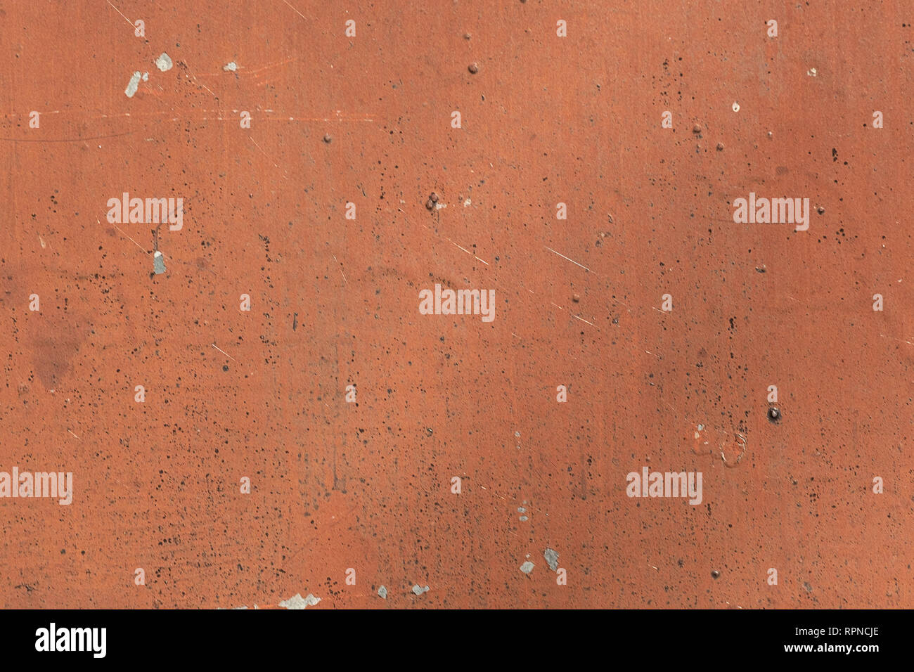 texture background metal reddish-brown color with small white and black dots - Stock Image