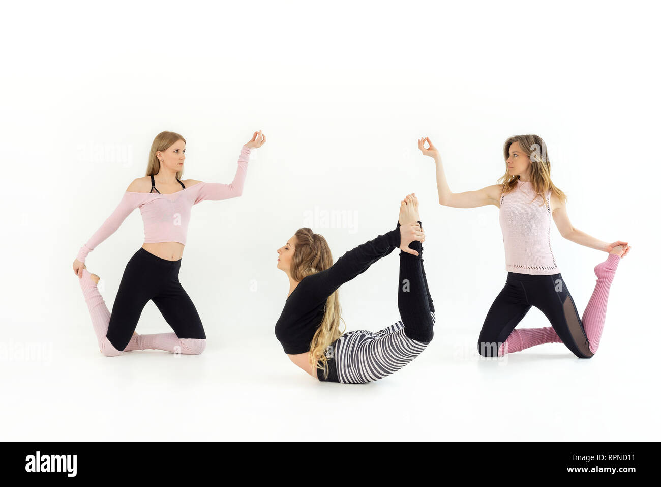 Three People Doing Yoga Poses High Resolution Stock Photography And Images Alamy
