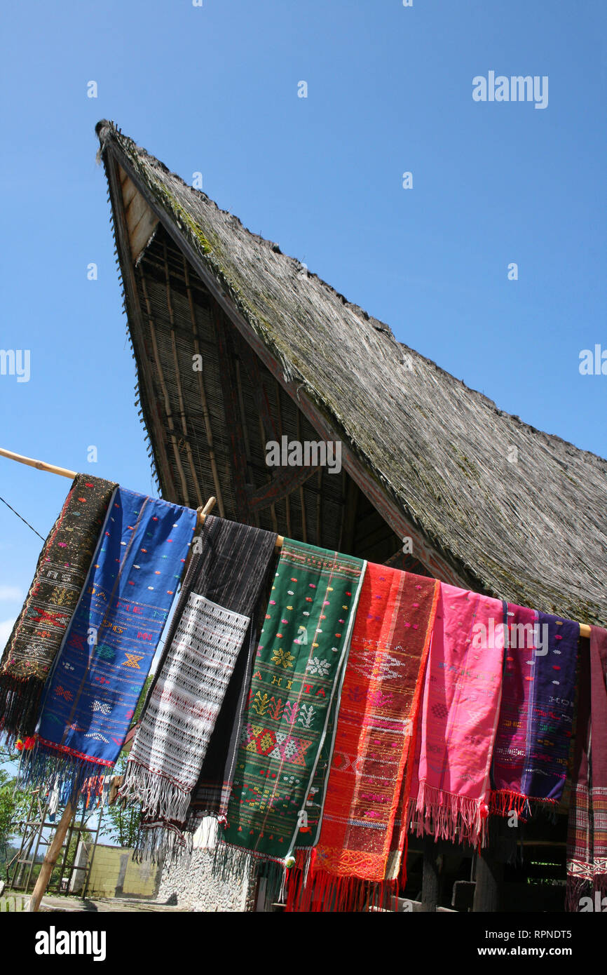 Ulos Hand Woven Textiles Outside A Traditional House - Stock Image