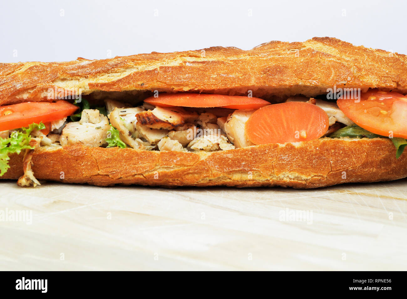 Fresh chicken sandwich. French baguette. France - Stock Image