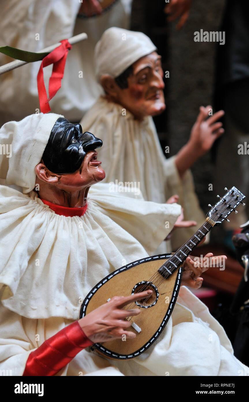 Naples, Italy  Figurine of Pulcinella playing a mandolin, Via San