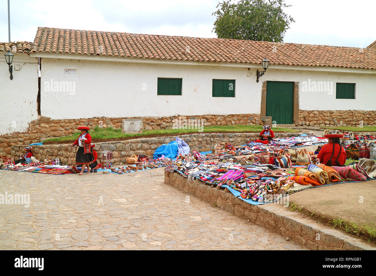Local People Walking at Traditional Market at the Hilltop Town Plaza of Chinchero, Cuzco, Peru - Stock Image
