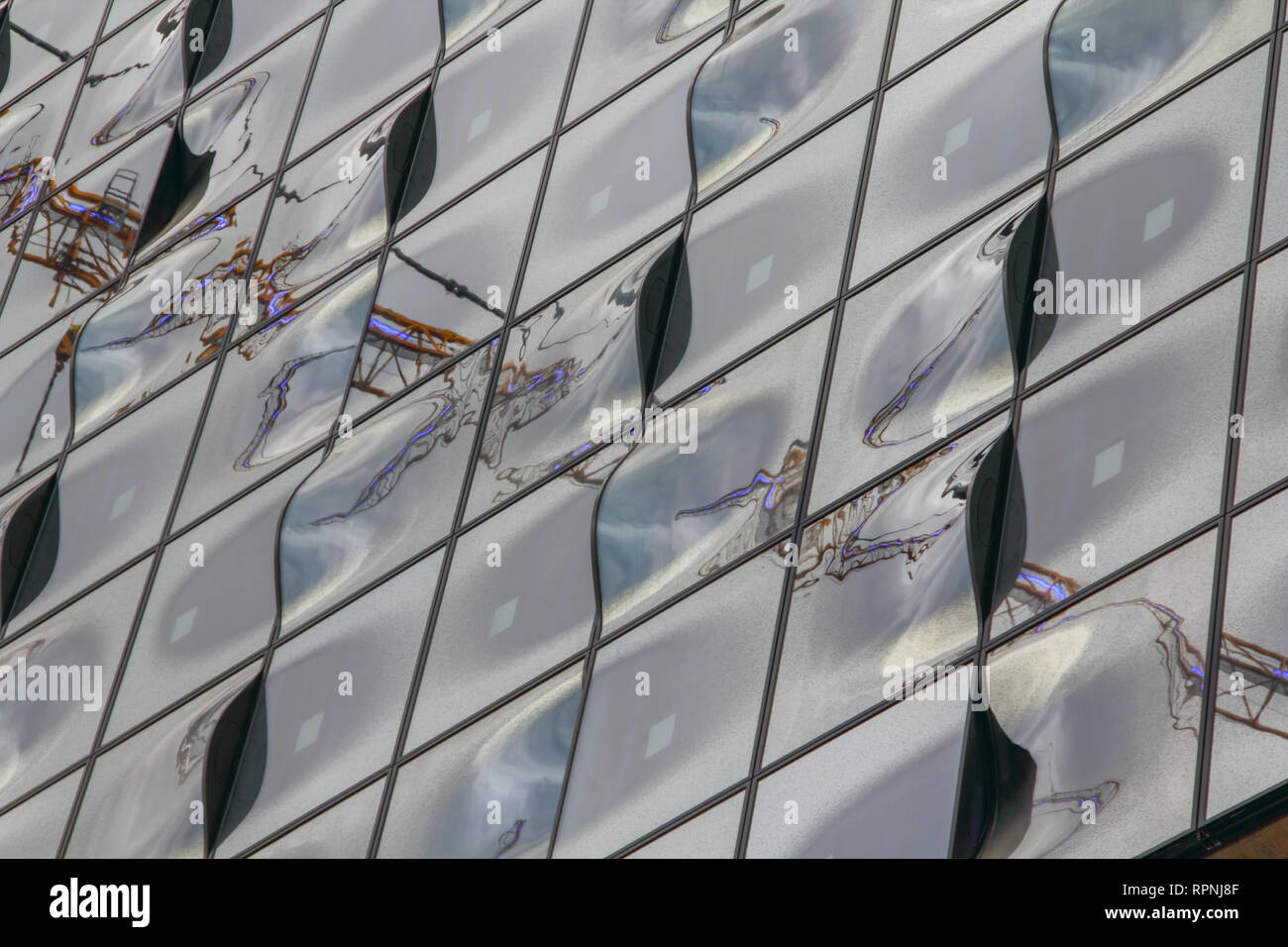 Reflections on glass wall panels of Philharmonie building Hamburg harbor impressions archival 2010 - Stock Image