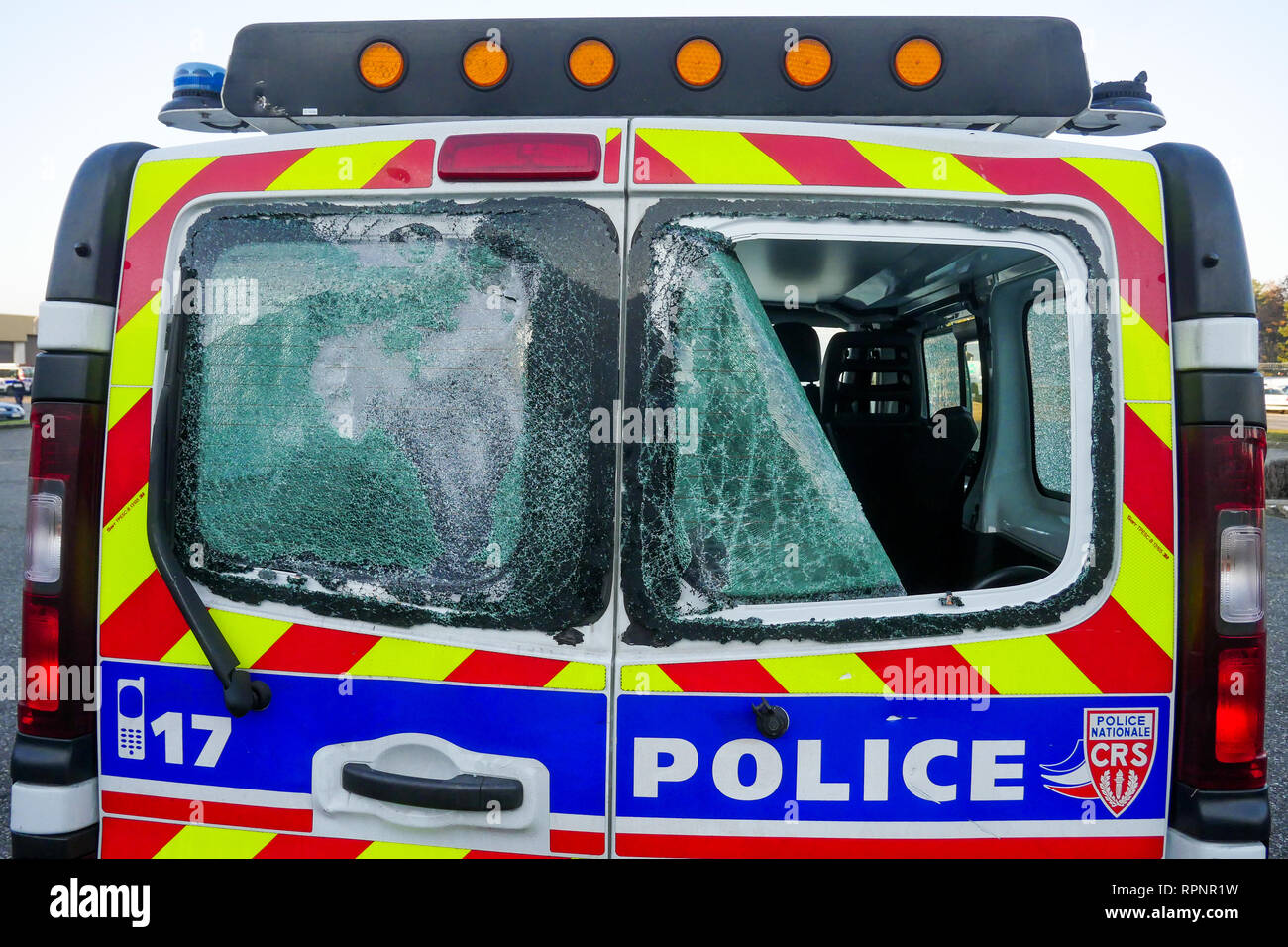 Police vehicle destroyed by the Yellow Jackets, Chassieu, France Stock Photo