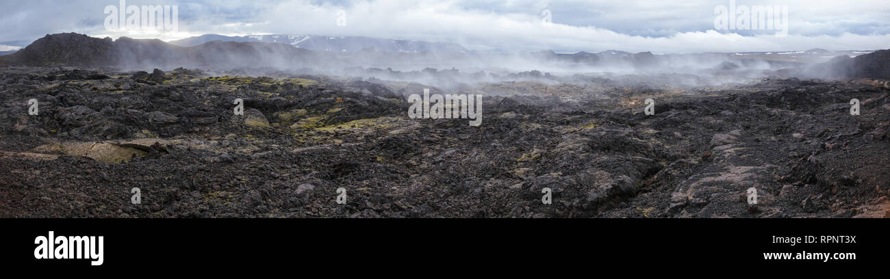 Panoramic view of steaming lava field at Krafla volcanic area in Mývatn region, Northeastern Iceland, Scandinavia - Stock Image
