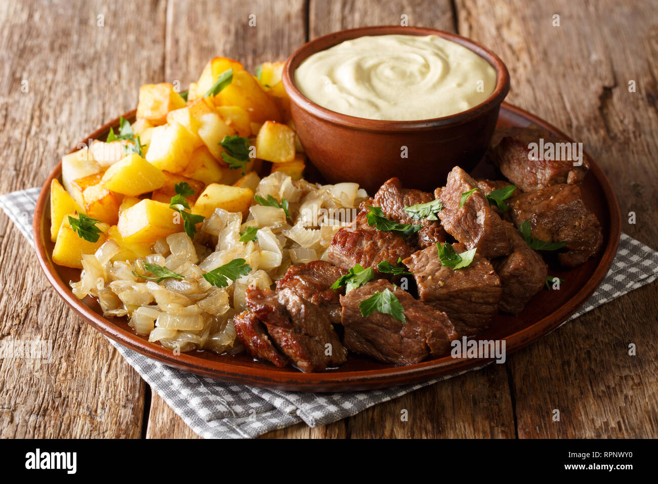 Fried Beef Rydberg served with onions and crisp potatoes with ...