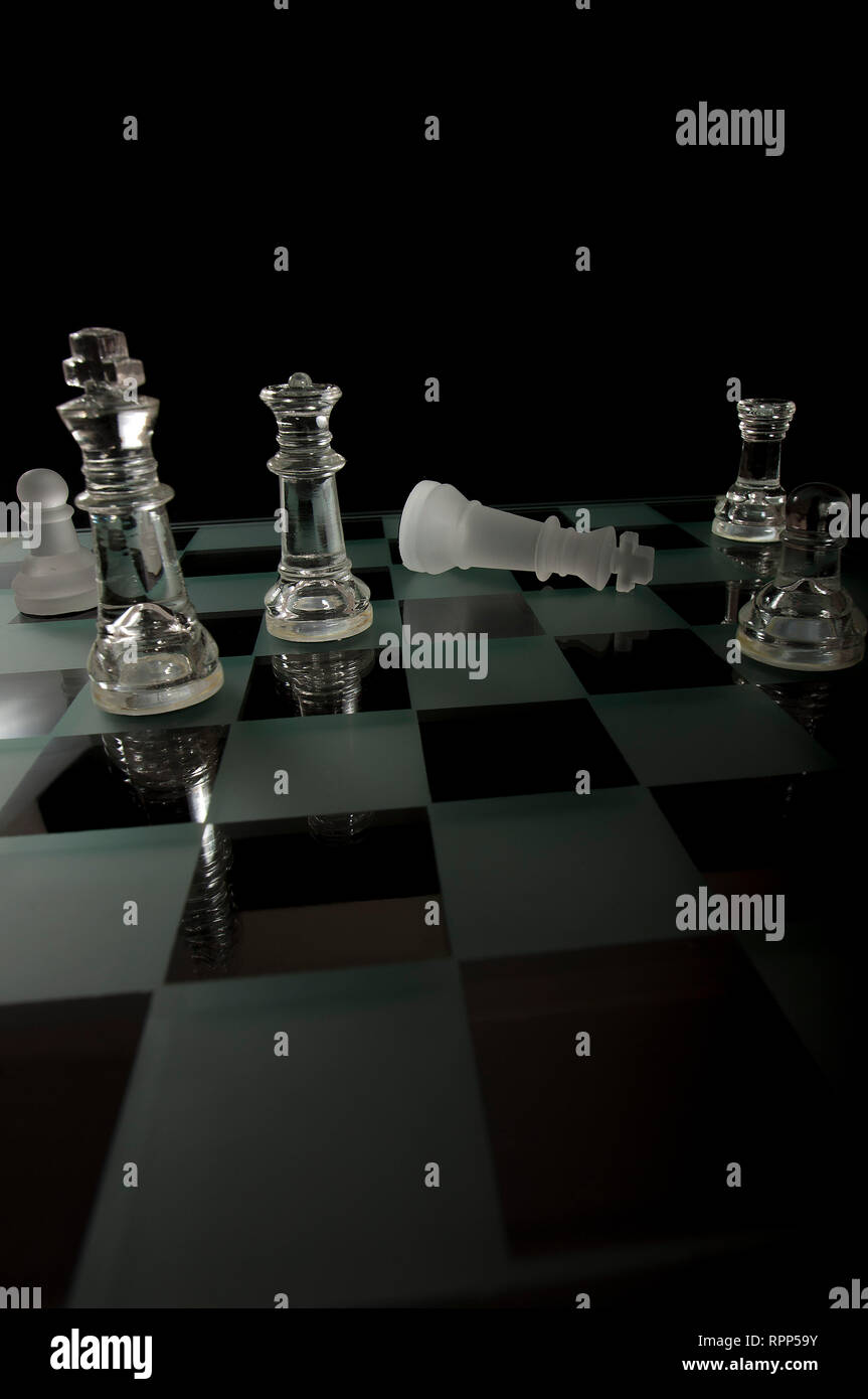 Checkmate Glass Chess Pieces - Stock Image