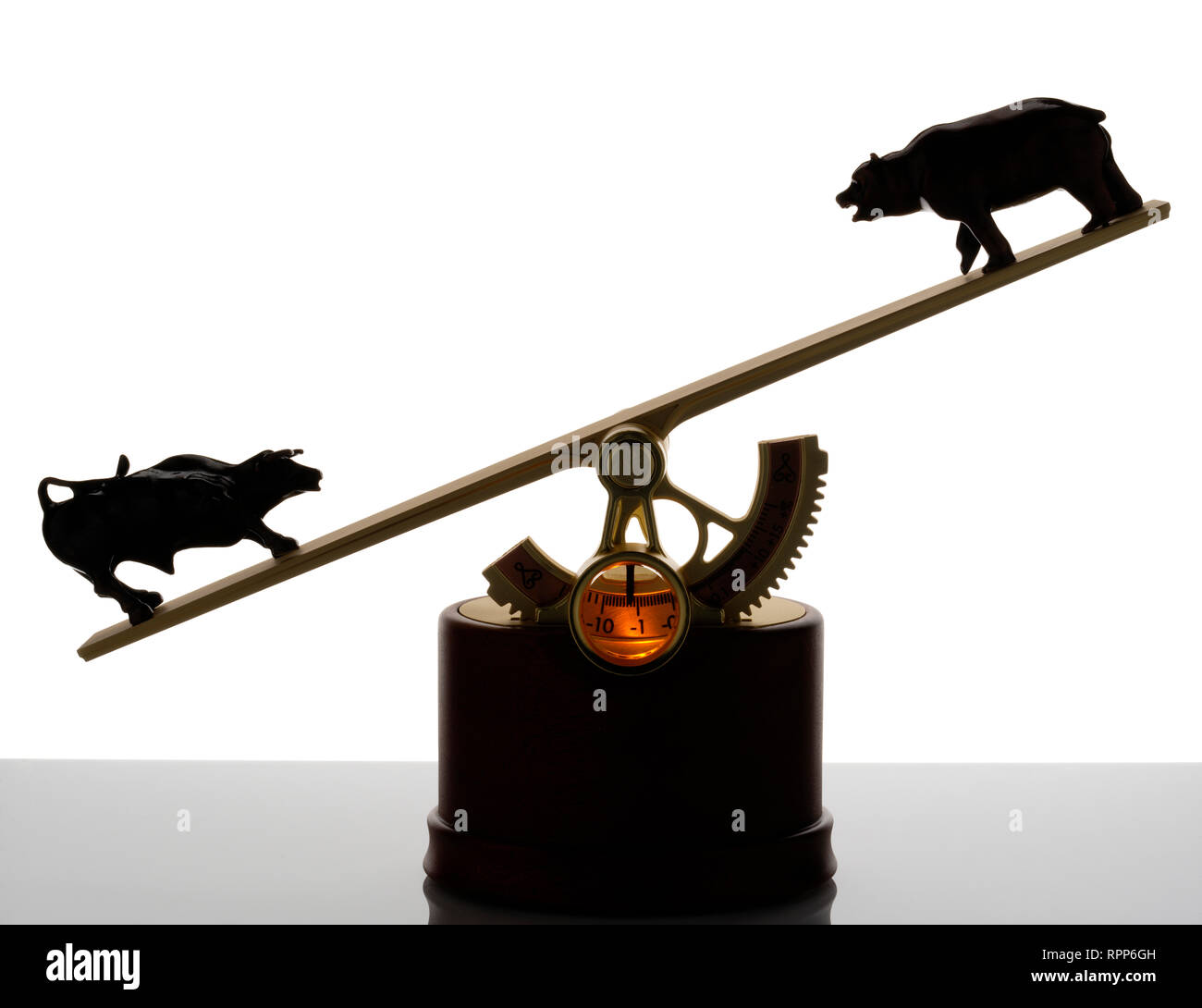 The Market, executive toy (!) that displays the balance of the stockmarket. Bull and bear at opposing ends of a see-saw. Stock Photo