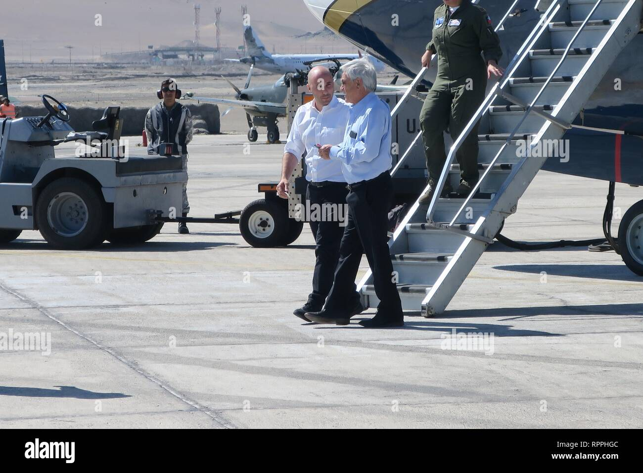 Chilean President Sebastian Pinera (R) prepares to get on the G-IV plane of the Chilean Air Force to continue his trip to Cucuta (Colombia), in Iquique, Chile, 22 February 2019. Pinera was forced to change planes this Friday in the middle of his trip to the Colombian city of Cucuta due to a failure in the presidential aircraft. The Chilean leader departed from Santiago to border the Boeing 737 of the Air Force, the smallest of the two that he usually uses on his trips, to the city of Iquique, where the aircraft would load fuel to continue his route to Cucuta, where he will attend the concert V - Stock Image