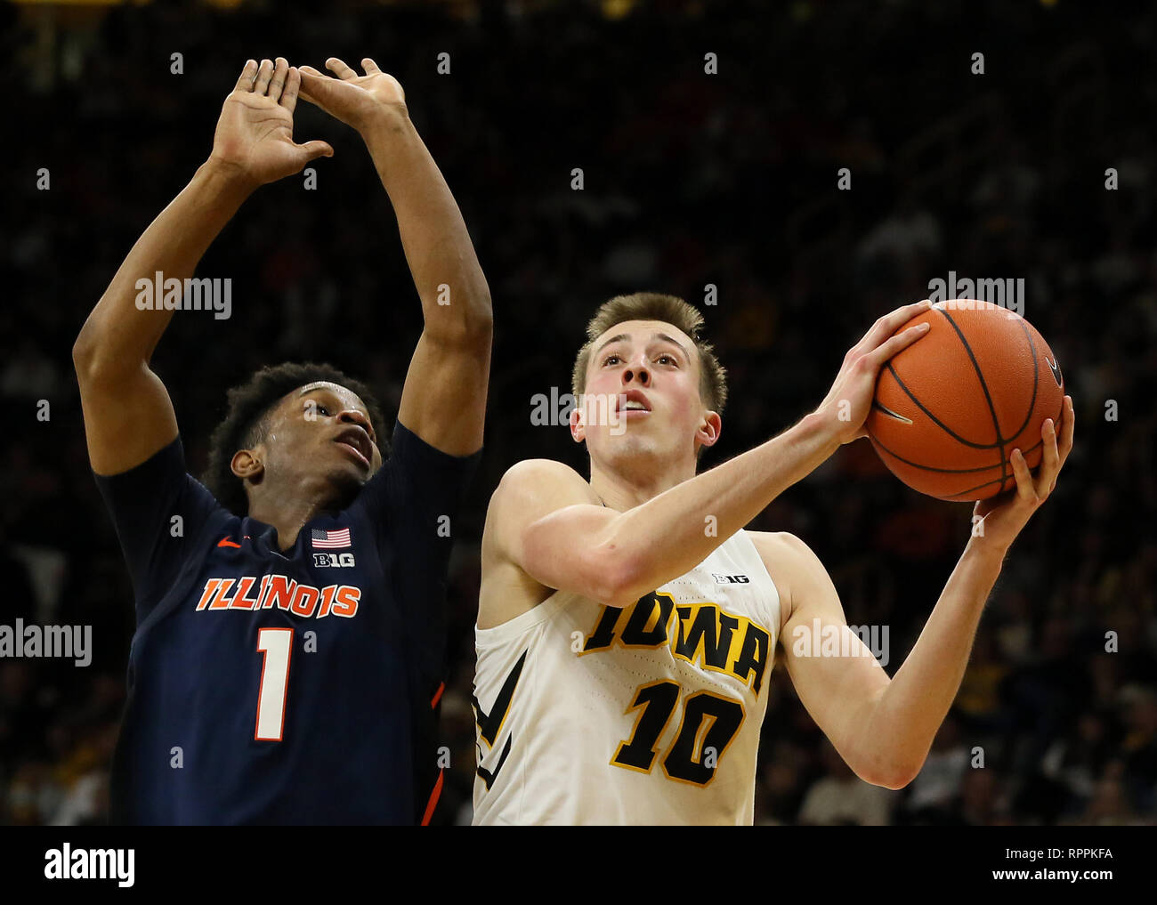 January 20, 2019 - Iowa City, Iowa, U.S. - Iowa's Joe Wieskamp #10 goes up for two-points against Illinois Trent Frazier #1 during Sunday's basketball game against the University of Illinois in Carver-Hawkeye Arena  in Iowa City. (Credit Image: © Kevin E. Schmidt/Quad-City Times via ZUMA Wire) - Stock Image