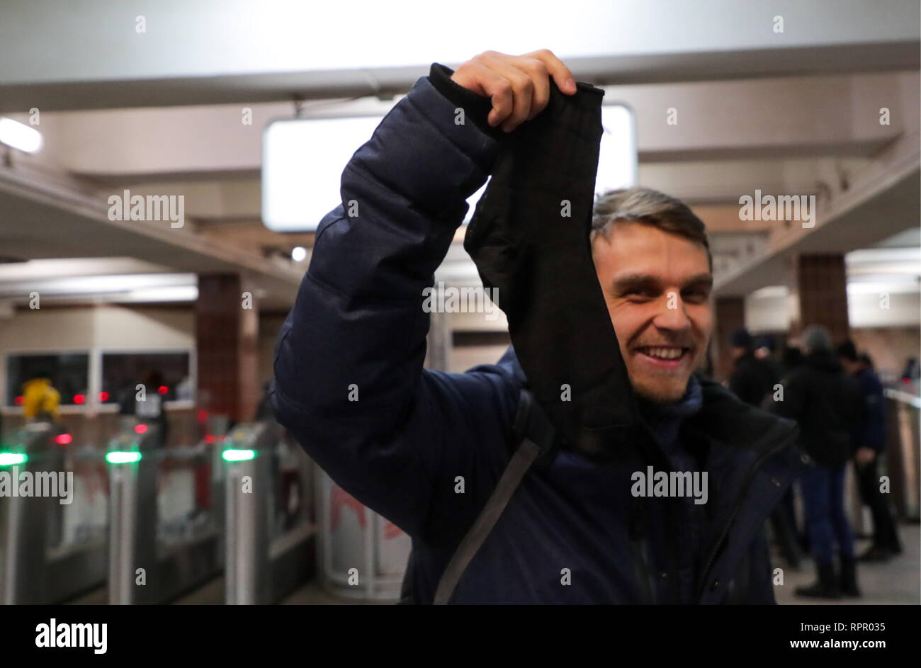 Moscow, Russia. 23rd Feb, 2019. A man shows a pair of socks given to him at the Komsomolskaya station of the Moscow Metro on Defender of the Fatherland Day. Vyacheslav Prokofyev/TASS Credit: ITAR-TASS News Agency/Alamy Live News Stock Photo
