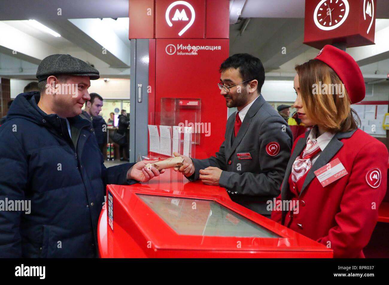 Moscow, Russia. 23rd Feb, 2019. Moscow Metro employees giving out socks to men at the Komsomolskaya station of the Moscow Metro on Defender of the Fatherland Day. Vyacheslav Prokofyev/TASS Credit: ITAR-TASS News Agency/Alamy Live News Stock Photo